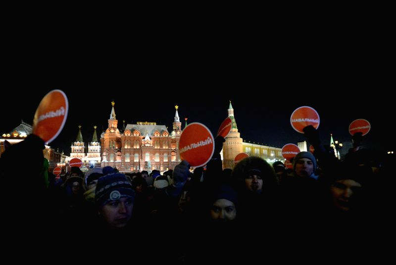 Alexei Navalny's supporters gather at Manezhnaya Square in Moscow, Russia, on Dec. 30, 2014. Russian activists gather at Manezhnaya square in Moscow after the ...