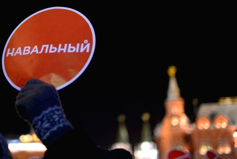 An Alexei Navalny's supporter holds a banner with Navalny's name at Manezhnaya Square in Moscow, Russia, on Dec.30, 2014. Russian activists gather at Manezhnaya ...