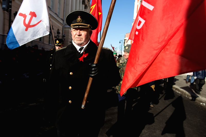 MOSCOW, Feb. 23, 2018 - A man passes by the red flags during a parade marking the Defender of the Fatherland Day in Moscow, Russia, on Feb. 23, 2018.