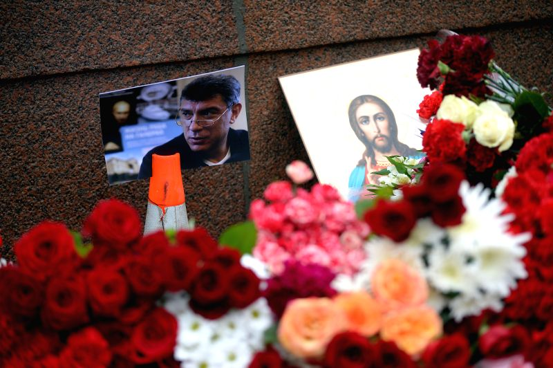 Flowers are laid on the site where Russian opposition leader and former deputy prime minister Boris Nemtsov was shot dead near the Red Square in Moscow Feb. 28, ... - Boris Nemtsov