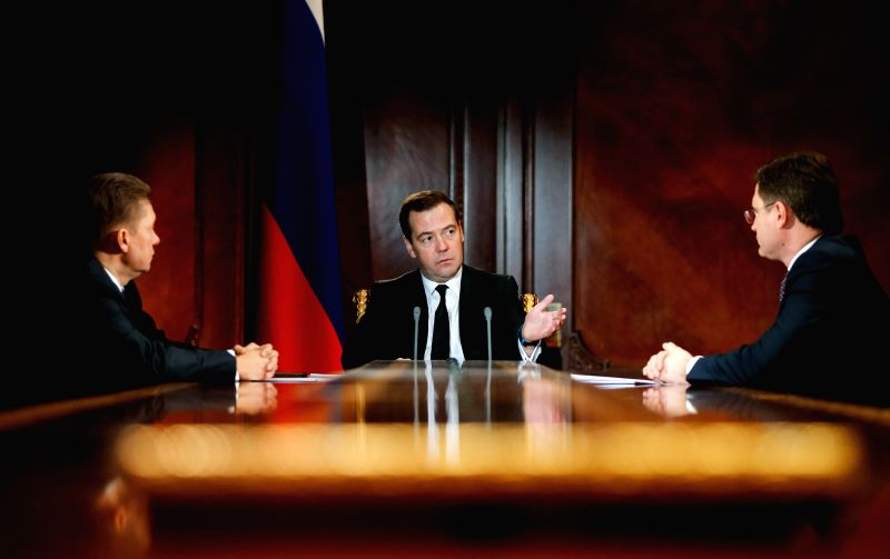 Russian Prime Minister Dmitry Medvedev (C) meets with Alexei Miller (L), the head of Russian gas giant Gazprom, and Energy Minister Alexander Novak, in Moscow, ... - Dmitry Medvedev