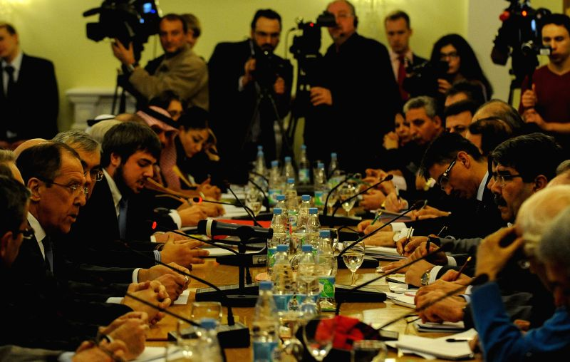 Russian Foreign Minister Sergey Lavrov (1st, L) speaks during talks between representatives of the Syrian government and the Syrian opposition in Moscow, Russia, on . - Sergey Lavrov