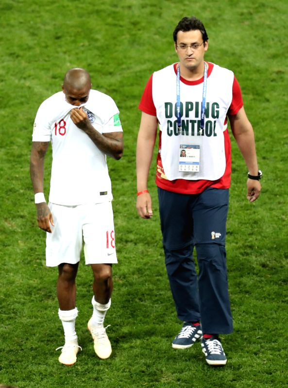 MOSCOW, July 11, 2018 - Ashley Young (L) of England leaves the pitch after the 2018 FIFA World Cup semi-final match between England and Croatia in Moscow, Russia, July 11, 2018. Croatia won 2-1 and ...