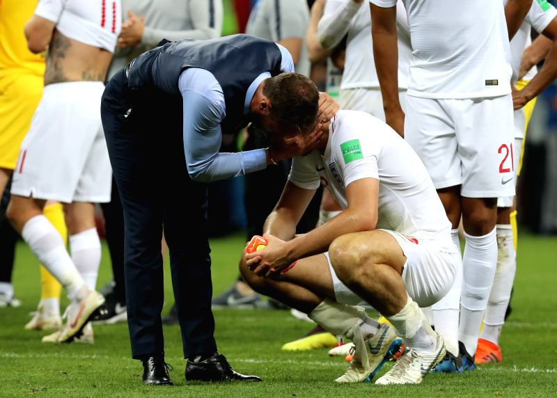 MOSCOW, July 11, 2018 - England's head coach Gareth Southgate (L) comforts Harry Maguire after the 2018 FIFA World Cup semi-final match between England and Croatia in Moscow, Russia, July 11, 2018. ...