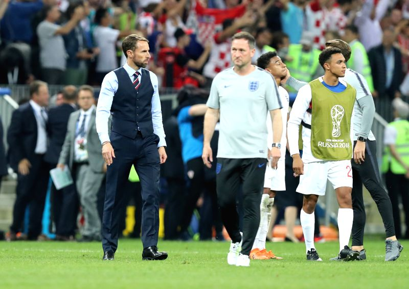 MOSCOW, July 11, 2018 - Head coach Gareth Southgate (1st L) of England is seen after the 2018 FIFA World Cup semi-final match between England and Croatia in Moscow, Russia, July 11, 2018. Croatia won ...