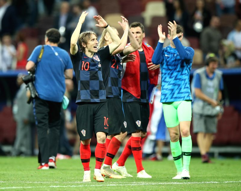 MOSCOW, July 11, 2018 - Luka Modric (1st L) of Croatia greets the audience after the 2018 FIFA World Cup semi-final match between England and Croatia in Moscow, Russia, July 11, 2018. Croatia won 2-1 ...
