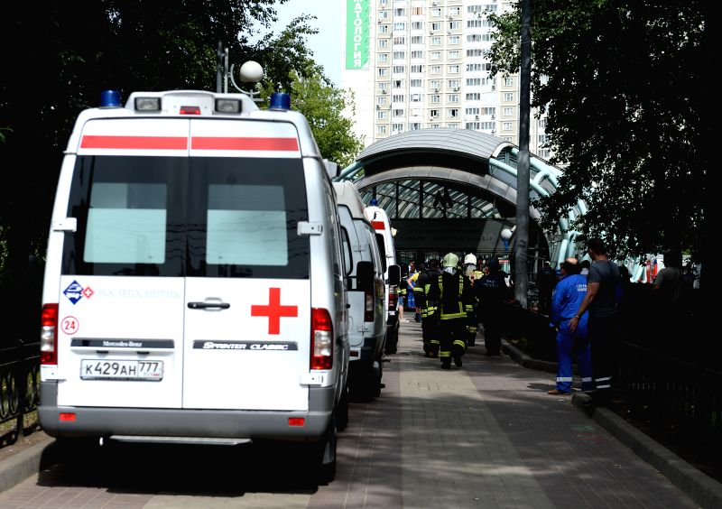 An ambulance parks outside the Slavyanski Bulvar subway station in Moscow, capital of Russia, on July 15, 2014. At least 16 people have been confirmed dead after a .. - Vladimir Puchkov