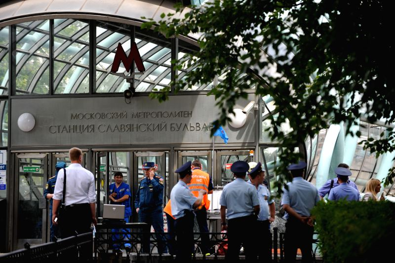 Rescuers and repair personnel work outside the Slavyanski Bulvar subway station in Moscow, capital of Russia, on July 15, 2014. At least 16 people have been ... - Vladimir Puchkov
