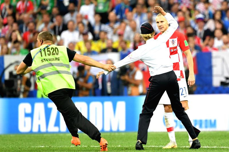 MOSCOW, July 15, 2018 - A steward grabs an invader during the 2018 FIFA World Cup final match between France and Croatia in Moscow, Russia, July 15, 2018.