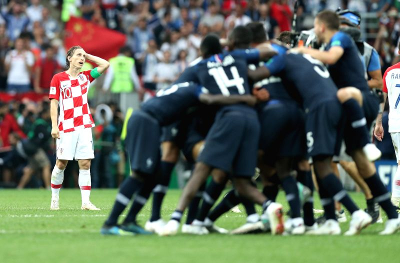 MOSCOW, July 15, 2018 - Luka Modric (L) of Croatia reacts after the 2018 FIFA World Cup final match between France and Croatia in Moscow, Russia, July 15, 2018. France defeated Croatia 4-2 and ...