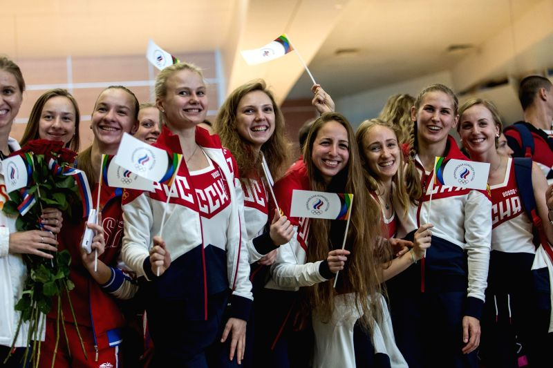 MOSCOW, July 28, 2016 - Russian athletes bid farewell to people at the Sheremetyevo airport in Moscow, Russia, July 28, 2016. About 70 Russian athletes left Moscow on Thursday for Rio de Janeiro to ...