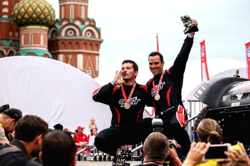 MOSCOW, July 28, 2018 - MCM Original's Mathieu Serradori (R Top) of France and Fabian Lurquin (L Top) of Belgium pose on the podium during the finish ceremony of Silk Way Rally-2018 on Red Square in ...