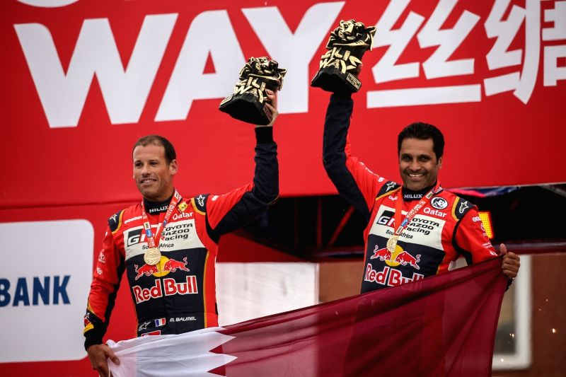 MOSCOW, July 28, 2018 - Toyota Hilux's Naser Al-Attiyah (R) of Qatar and Mathieu Baumel of France celebrate on the podium during the finish ceremony of Silk Way Rally-2018 on Red Square in Moscow, ...