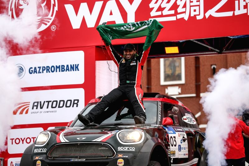 MOSCOW, July 28, 2018 - X-Raid MINI John Cooper Works Rally's Yazeed Al-Rahji of Saudi Arabia waves the flag during the finish ceremony of Silk Way Rally-2018 on Red Square in Moscow, Russia, on July ...