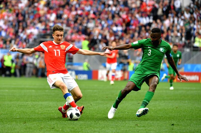 MOSCOW, June 14, 2018 - Russia's Aleksandr Golovin (L) vies with Saudi Arabia's Osama Hawsawi during the opening match of the 2018 FIFA World Cup in Moscow, Russia, on June 14, 2018.