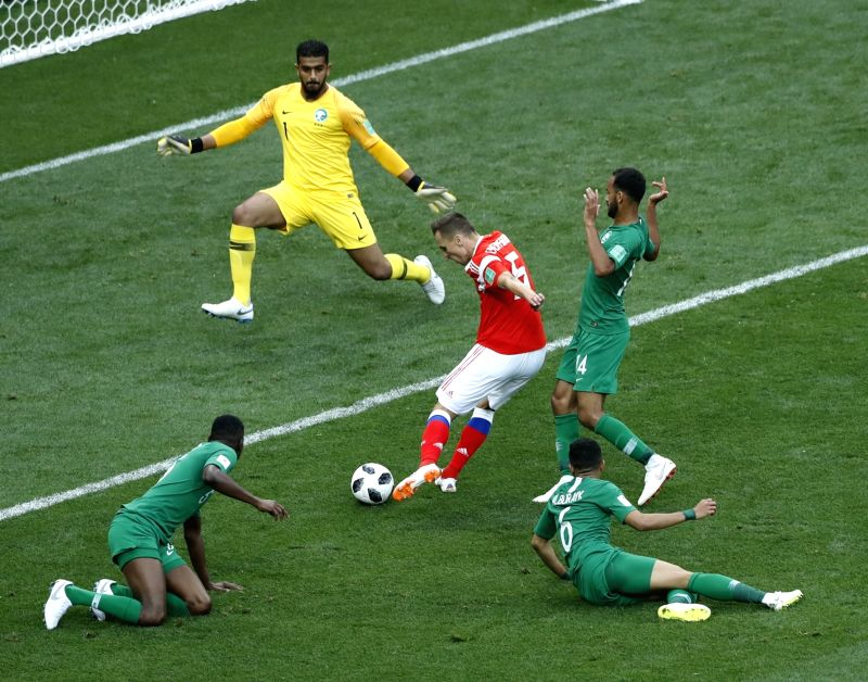 MOSCOW, June 14, 2018 - Russia's Denis Cheryshev (C) scores his goal against Saudi Arabia during the opening match of the 2018 FIFA World Cup in Moscow, Russia, on June 14, 2018.