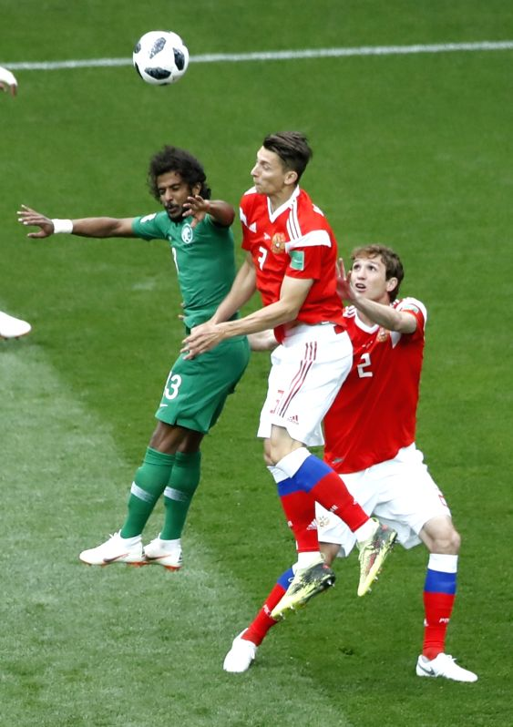 MOSCOW, June 14, 2018 - Russia's Ilya Kutepov (C) competes during the opening match of the 2018 FIFA World Cup in Moscow, Russia, on June 14, 2018.