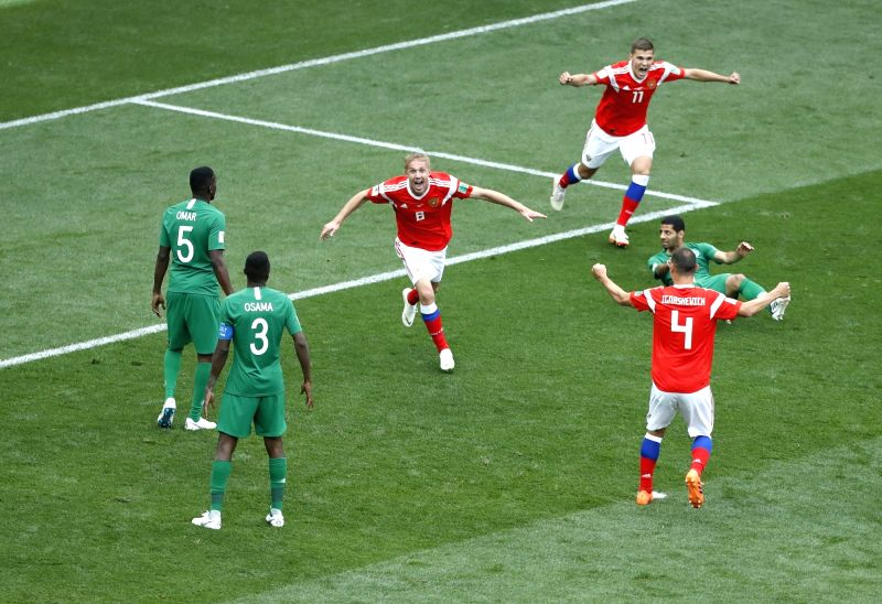 MOSCOW, June 14, 2018 - Russia's Iury Gazinsky (C) celebrates his first goal during the opening match of the 2018 FIFA World Cup in Moscow, Russia, on June 14, 2018.