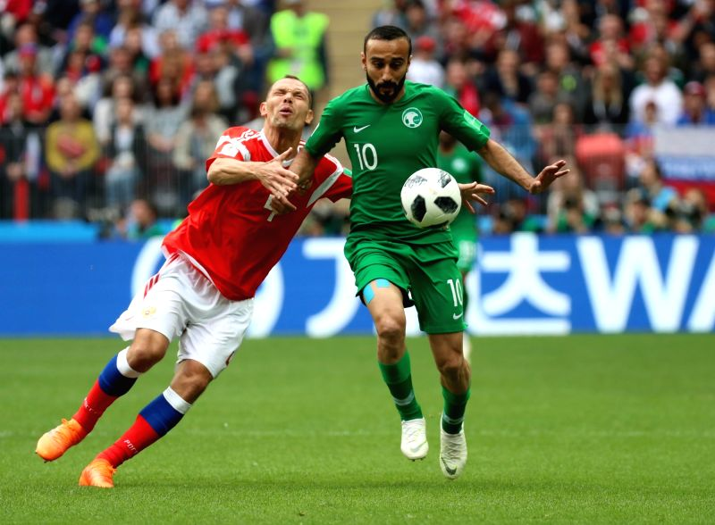 MOSCOW, June 14, 2018 - Saudi Arabia's Mohammed Alsahlawi (R) vies with Russia's Sergey Ignashevich during the opening match of the 2018 FIFA World Cup in Moscow, Russia, on June 14, 2018.