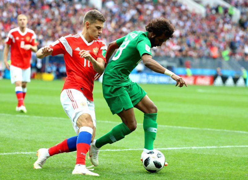 MOSCOW, June 14, 2018 - Saudi Arabia's Yasir Alshahrani (R) vies with Russia's Roman Zobnin during the opening match of the 2018 FIFA World Cup in Moscow, Russia, on June 14, 2018.