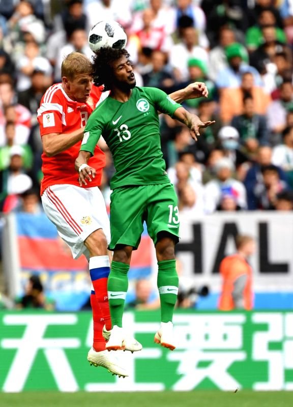 MOSCOW, June 14, 2018 - Saudi Arabia's Yasir Alshahrani (R) vies with Russia's Iury Gazinsky during the opening match of the 2018 FIFA World Cup in Moscow, Russia, on June 14, 2018.