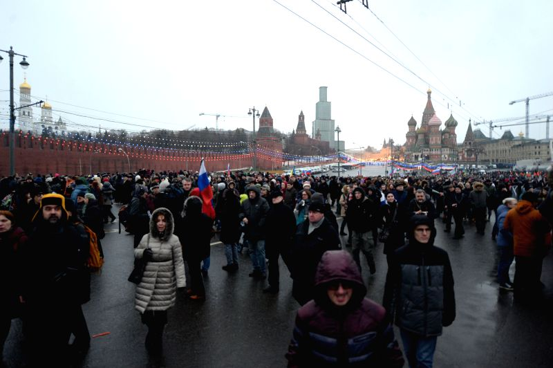 People take part in the rally in memory of murdered Russian opposition leader Nemtsov who was killed on Saturday in the center of Moscow, Russia, on March. 1, 2015. ...