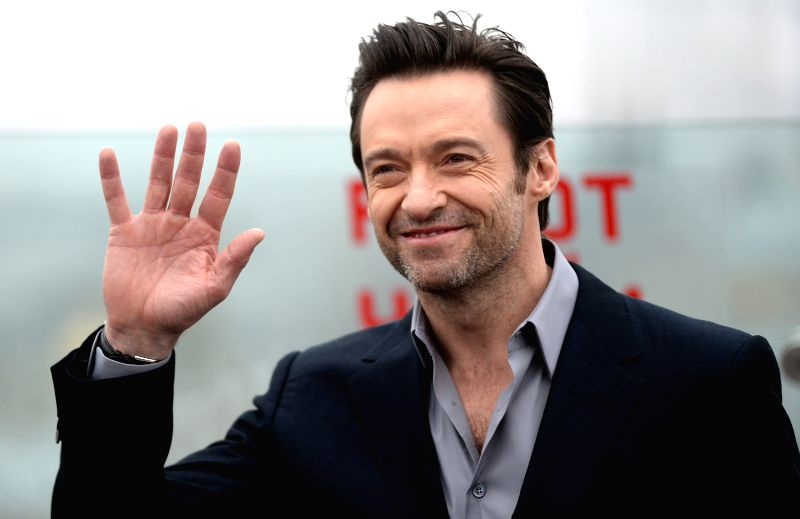 "Actor Hugh Jackman poses at the photocall for new movie ""CHAPPiE"" directed by Neiill Blomkamp in Moscow, Russia, on March 1, 2015. (Xinhua/Pavel ... - Hugh Jackman"