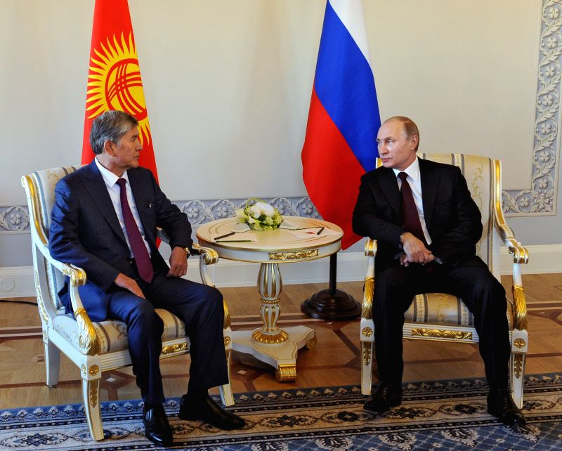 Russian President Vladimir Putin (R) meets with his visiting Kyrgyz counterpart Alazbek Atambayev in St. Petersburg, Russia, on March 16, 2015. It was the Russian ...