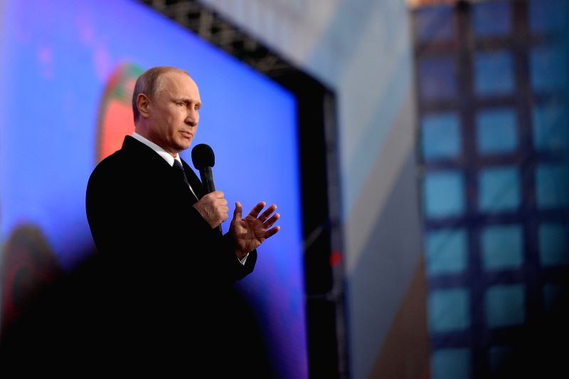 Russian President Vladimir Putin speaks at a celebration to mark the first anniversary of Crimea's incorporation into Russia, in Moscow, Russia, March 18, 2015. ...