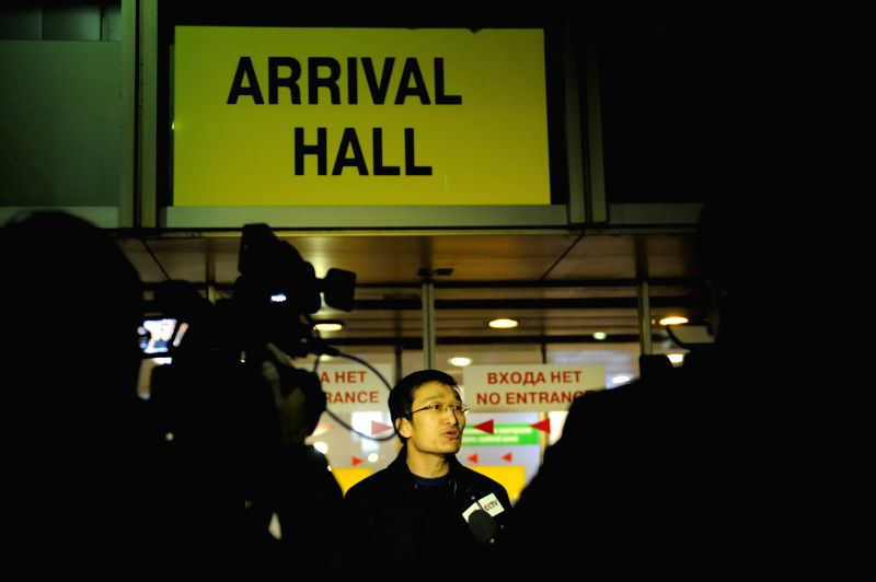A Chinese national speaks to reporters at the Sheremetyevo airport in Moscow, Russia, March 7, 2015. Dozens of Chinese passengers were detained at the Sheremetyevo ...