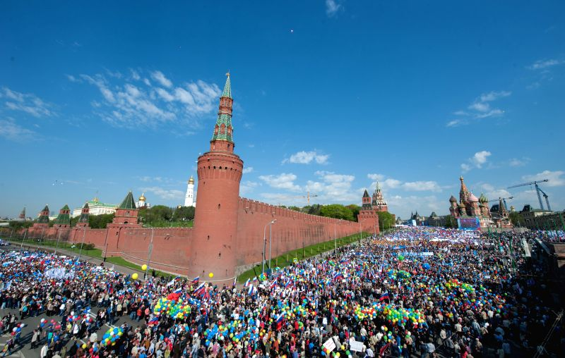 People attend a parade marking the International Labor Day on the Red Square in Moscow, on May 1, 2014. It was the first grand rally of the Labor Day on the Red Square