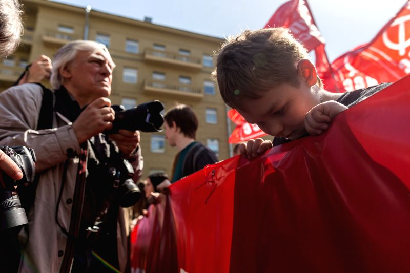 MOSCOW, May 1, 2017 - A boy looks down during the Labor day demonstration in Moscow, Russia, on May 1, 2017. Communist party of Russia carried out its traditional Labor day demonstration, passing ...