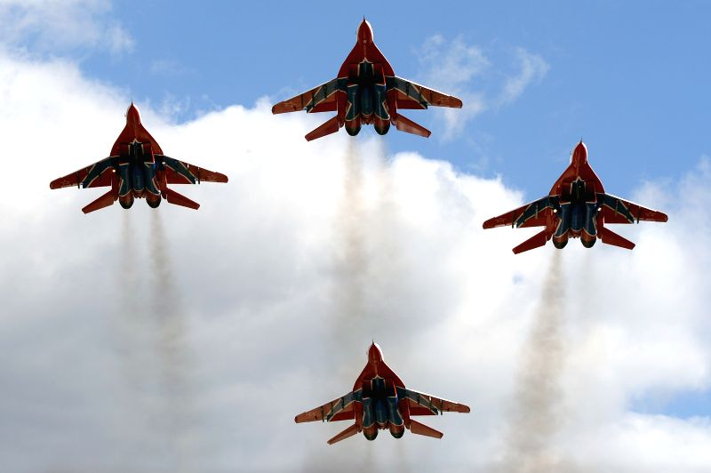 The Swifts aerobatic team flys during the miliary parade rehearsal in Kubinka, Russia, May 5, 2015. The military parade will be held in Russia to mark the 70th ...