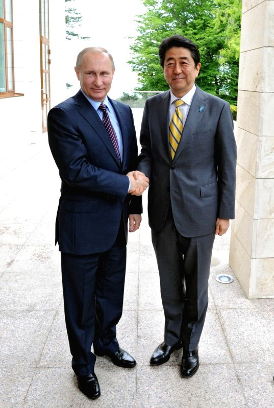 MOSCOW, May 6, 2016 - Russian President Vladimir Putin (L) meets with visiting Japanese Prime Minister Shinzo Abe at Sochi, Russia on May 6, 2016. Russian President Vladimir Putin and visiting ... - Shinzo Abe