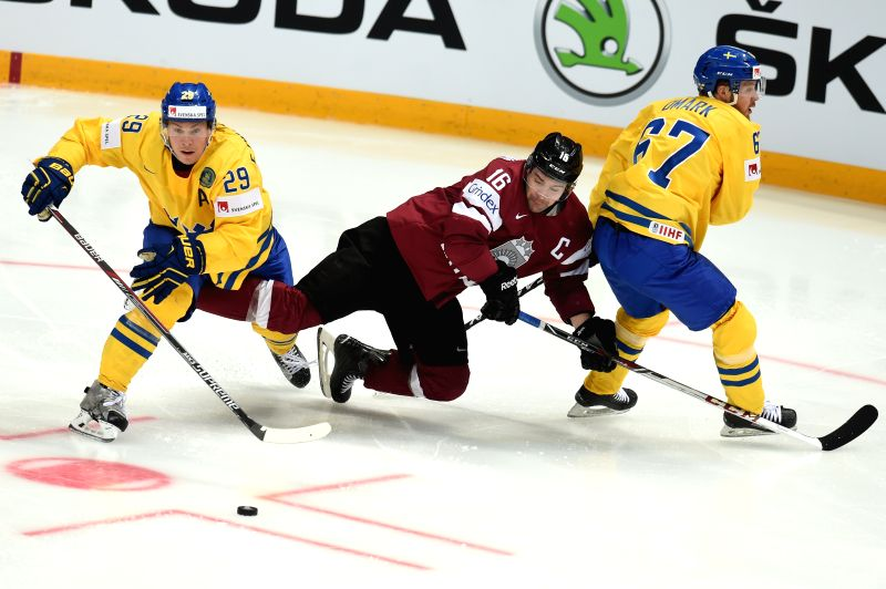MOSCOW, May 7, 2016 - Erik Gustafsson (L) and Linus Omark (R) of Sweden vies with Kaspars Daugavins of Latvia during preliminary round of IIHF Ice Hockey World Championship in Moscow, Russia, on May ...