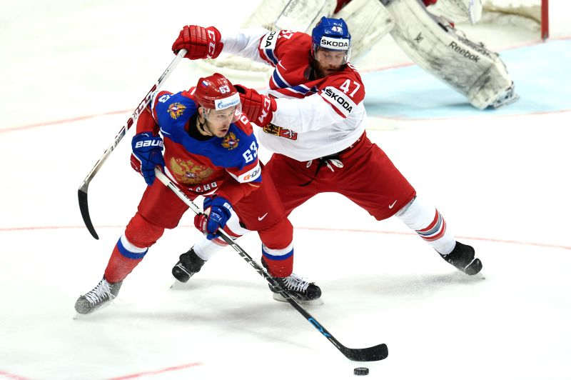 MOSCOW, May 7, 2016 - Yevgeni Dadonov of Russia (L) vies with Michal Jordan of Czech Republic during their 2016 IIHF Ice Hockey World Championship Group A match in Moscow, Russia, on May 6, 2016. ...