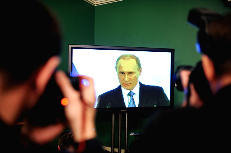 Moscow (Russia): Photographers take photos as Russian President Vladimir Putin gives his annual state of the nation address in the Kremlin in Moscow, Russia, Dec. 4, 2014.