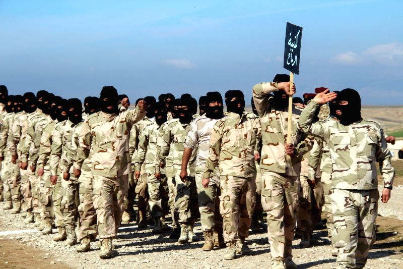 Government-backed Sunni Arab tribesmen from paramilitary groups are reviewed at the end of their training period to fight Islamic State (IS) militants in northeast of .
