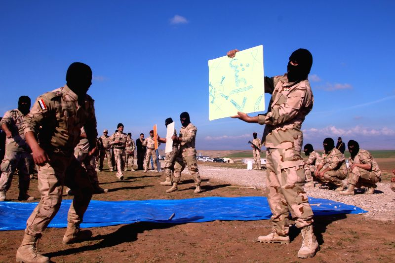 Government-backed Sunni Arab tribesmen from paramilitary groups demonstrate their skills at the end of their training period to fight Islamic State (IS) militants in ..