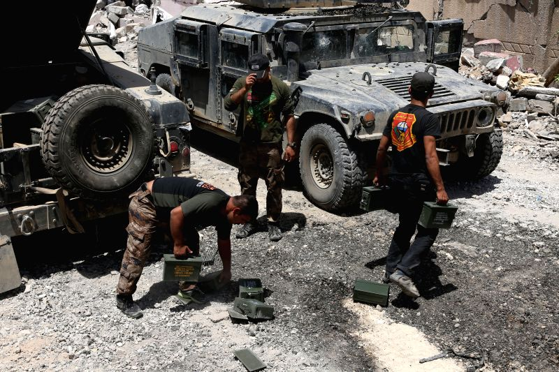 MOSUL (IRAQ), May 29, 2017 Iraqi soldiers carry ammunition in al-Saha neighborhood of western Mosul, Iraq on May 29, 2017. Iraqi Prime Minister Haider al-Abadi said on Monday that Iraqi ... - Haider