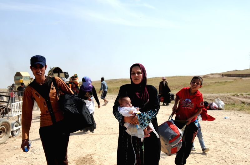 MOSUL, May 10, 2017 - Iraqi civilians arrive at the northwestern suburb of Mosul after fleeing the ongoing battle in the city on May 9, 2017. The United Nations Assistance Mission for Iraq (UNAMI) ...