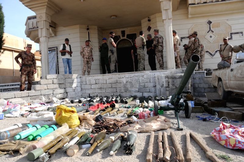 MOSUL, May 10, 2017 - Seized arms and ammunition are displayed in the northwestern suburb of Mosul, Iraq, May 9, 2017.