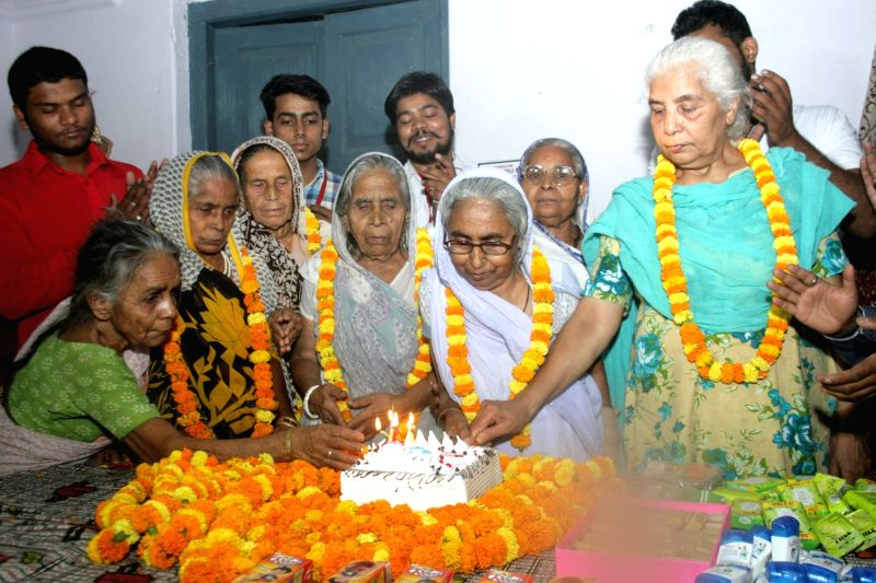 Mother's Day being celebrated at an old age home in Varanasi on May 8, 2016.