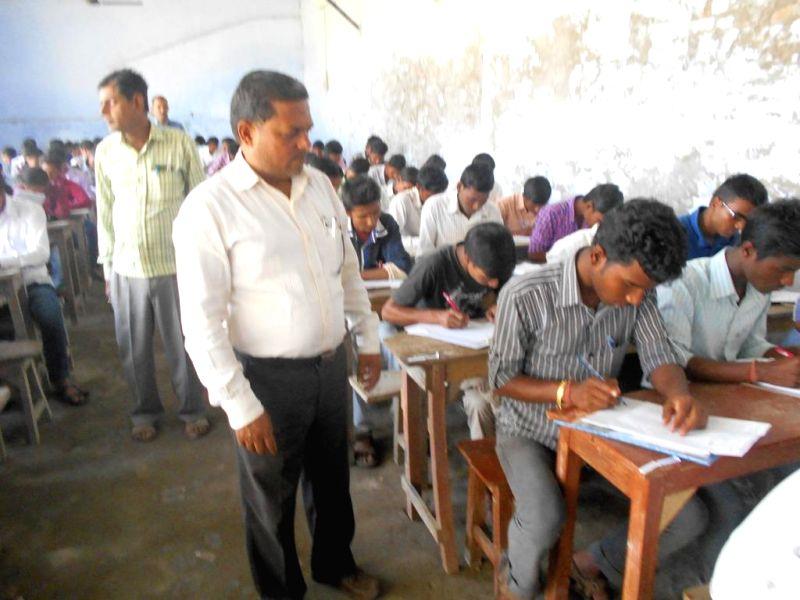 An invigilator during board exam duty in Motihari of Bihar on March 19, 2015.