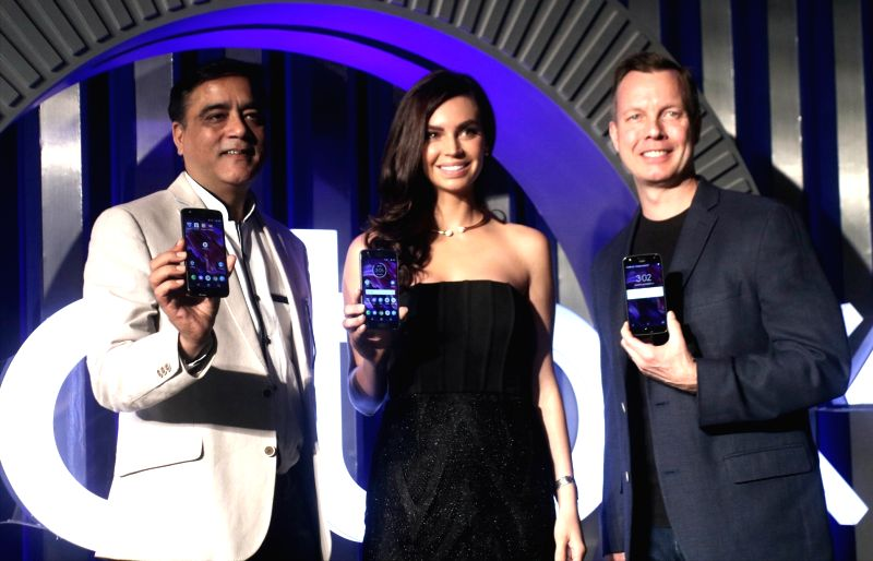 Motorola Mobility India MD Sudhin Mathur, model Sarah Todd and Motorola head of global product marketing Jim Thiede during the launch of Moto X4 smartphone in New Delhi on Nov 13, 2017. - Sarah Todd