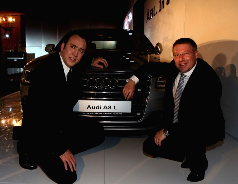 Mr. Joe King, Head, Audi India with Hollywood Actor Nicolas Cage at the launch of New Audi A8 L.