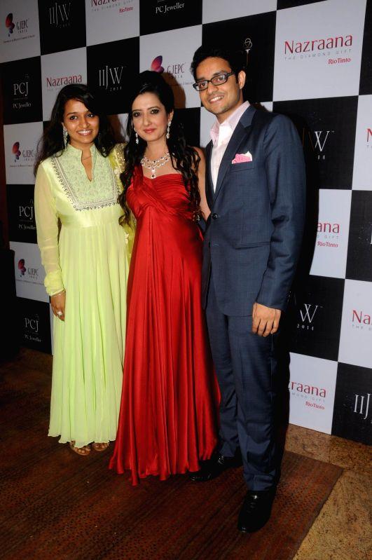 MR. & Mrs. Pranay Saboo with Amy Billimoria during the India International Jewellery Week (IIJW) in Mumbai, on July 16, 2014.