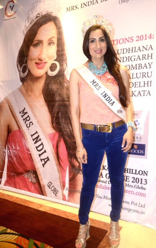 Mrs. India Globe 2013 Bir Kaur Dhillon during a press conference in Mumbai on July 4, 2014.