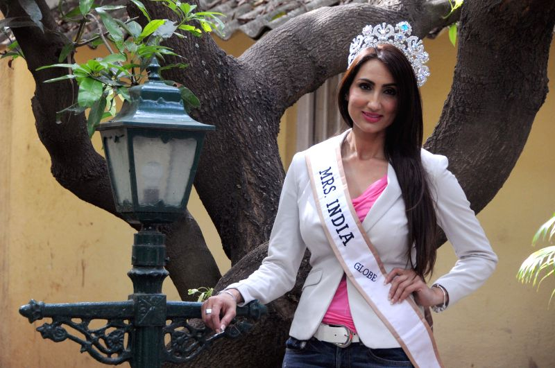 Mrs. India Globe 2013 Bir Kaur Dhillon poses for a photograph in Bangalore on July 2, 2014.