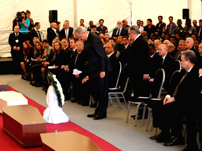 EU Commissioner for Migration Dimitris Avramopoulos pays his condolence during inter-faith service held under a provisional marquee at Mater Dei Hospital for 24 ... - Joseph Muscat